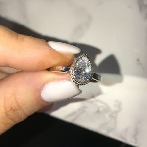 Crislu 101 facet pear gold halo engagement ring